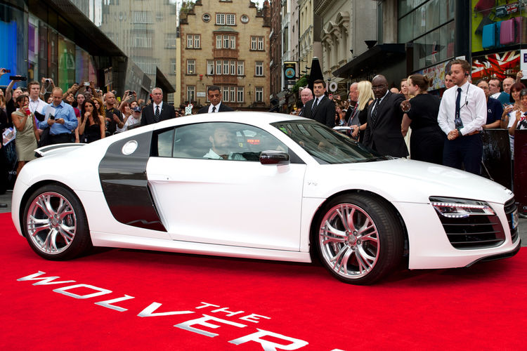 Hugh Jackman arrives at The Wolverine premiere in Audi R8