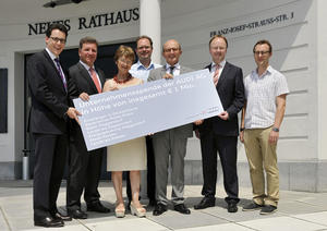 Audi flood aid: corporate donation handed over