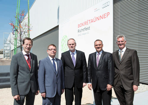 Audi Hungaria celebrated the roofing ceremony for the plant expansion: An automobile production plant with a complete process chain – from a press shop, body shop and paint shop all the way to an assembly hall – is being built at the Győr site. The company plans to invest more than €900 million in expansion of the plant. Starting in 2013, Győr will produce 125,000 automobiles per year. The first model will be an A3 derivative.