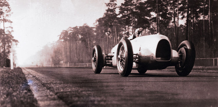 "First appearance of the Auto Union ""Silver Arrow"" on the Avus race track in Berlin 1934: Hans Stuck at the wheel of the Auto Union Typ A race car"