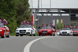The team in Audi cabriolets