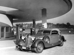"A filling station on the German ""autobahn"" at the end of the Thirties: A Horch 853 Sport-Cabriolet (1935 - 1940) is having its tank filled with the petrol (gasoline) and benzene mixture that was in use at that time."