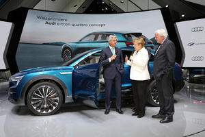Audi CEO Professor Rupert Stadler welcomes Chancellor Dr. Angela Merkel alongside the Minister-President of Hesse Volker Bouffier at the Audi exhibition space during the IAA International Motor Show in Frankfurt.