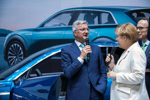 Audi CEO Professor Rupert Stadler welcomes Chancellor Dr. Angela Merkel and VDA-President Matthias Wissmann at the Audi exhibition space during the IAA International Motor Show in Frankfurt.