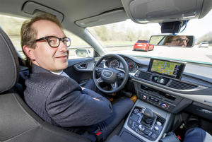Federal Minister of Transport Alexander Dobrindt tests piloted Audi