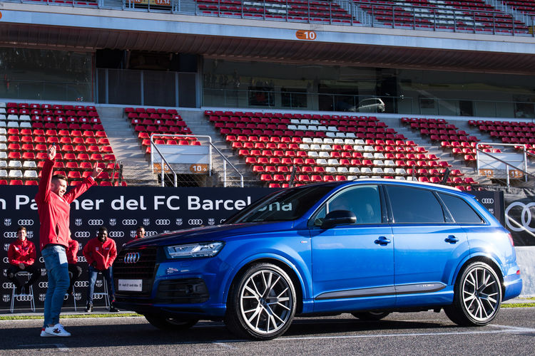 Footballers of FC Barcelona drive Audi