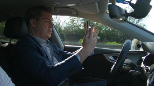 """Dr. Markus Söder, Bayerischer Ministerpräsident bei einer Testfahrt im automatisierten Forschungsauto """"Audi A7 piloted driving concept""""."""