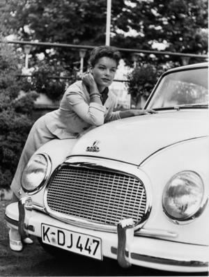 Actress Romy Schneider with an DKW 3=6 F 93 built in 1957
