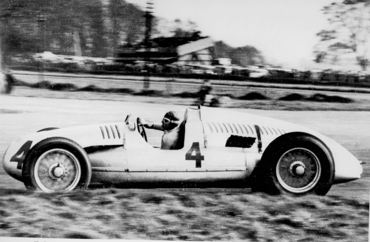 Tazio Nuvolari drove the Auto Union 12-cylinder Type D racing car (start number 4) to victory in the 1938 Grand Prix at Donington Park, Great Britain