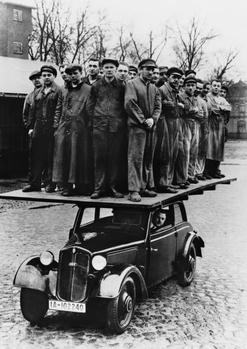 """30 men on the roof of a DKW """"Front Reichsklasse"""" Type F7. The photo was taken to demonstrate the strength of the DKW`s wooden coachwork."""